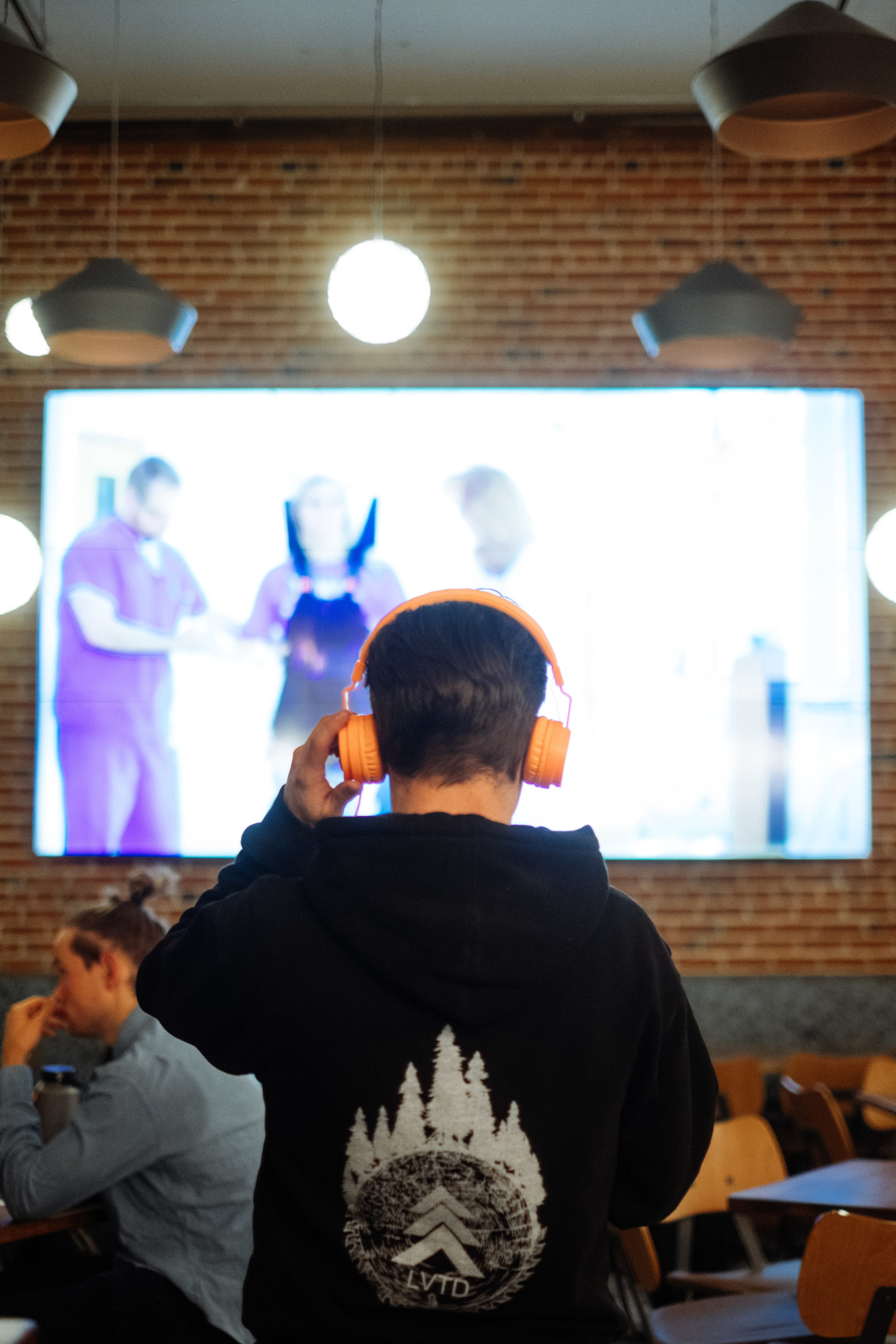 Man with Headphones Watching Screen