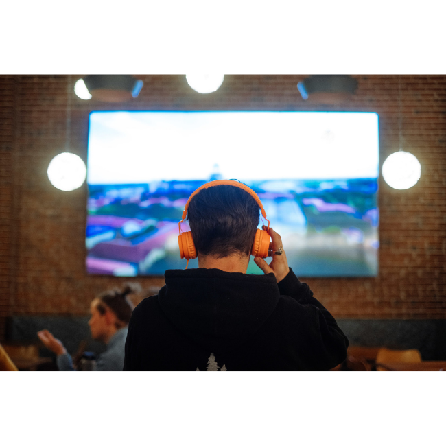 Man Using AudioFetch at Sports Bar